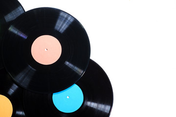 Old used vinyl record on a white background
