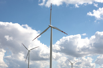 wind turbine landscape blue sky green grass