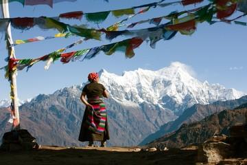 Nepalese woman and Langtang peak