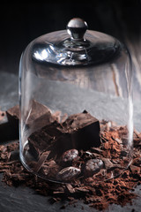 Chocolate and cocoa beans and glass Cloche