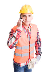 Professional and modern builder using smartphone