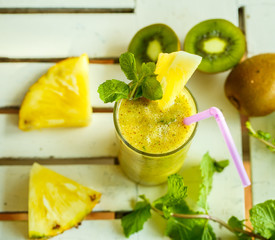 Smoothies of kiwi and pineapple on the table. Top view