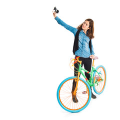 Eoman making a selfie with her colorful bicycle