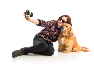 Girl making a selfie with her dog