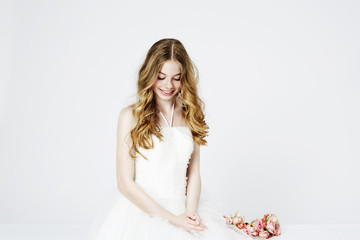 Teenage flower girl in white