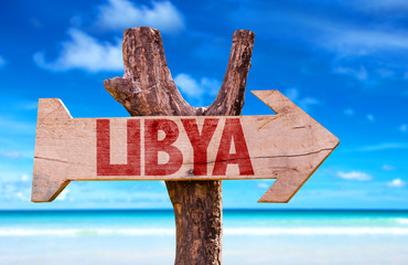 Libya wooden sign with ocean background