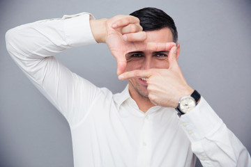 Businessman making frame with fingers