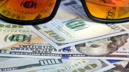 Sunglasses reflecting money