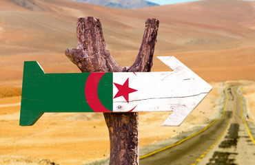 Foto op Aluminium Algerije Algeria Flag wooden sign with desert road background