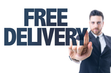 Business man pointing the text: Free Delivery