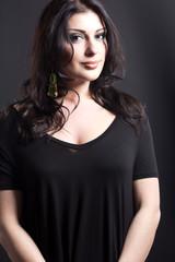 Attractive brunette on a black background.