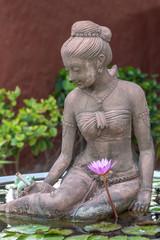 Thai style lady statue in big lotus pot