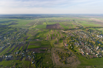Aerial view of a green rural area under blue sky. Ukraine
