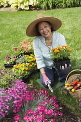Senior Asian woman gardening
