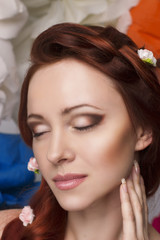 Beautiful girl with a lot of flowers in their hair and make-up