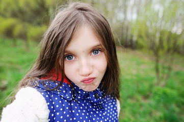 Adorable pre-teen kid girl  makes selfi