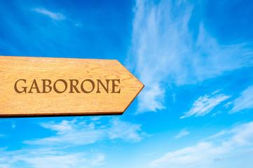 Wooden arrow sign pointing destination Gaborone, Botswana
