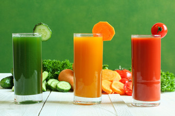 Fresh vegetable juices on wooden table