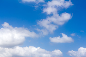 Blue sky and white fluffy clouds.