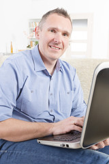 Hearing impaired man working with laptop
