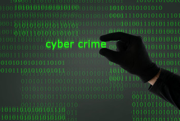 hacker holding cyber crime from binary code computer screen
