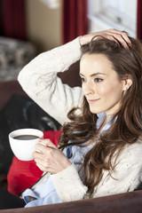 Woman enjoying fresh coffee