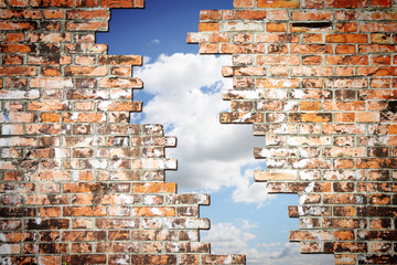 Through a crack of a brick wall you see the sky - concept image