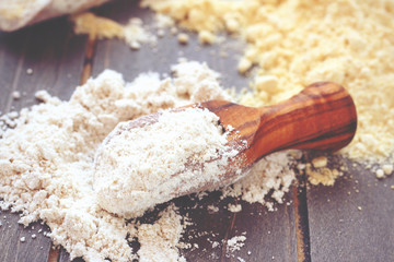 Gluten free chickpeas flour in wooden scoop