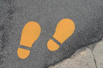 Yellow Footprints Symbol On A Walking Track
