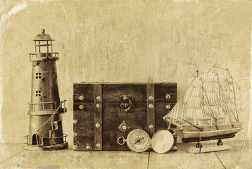 antique compass, vintage lighthouse, wooden boat