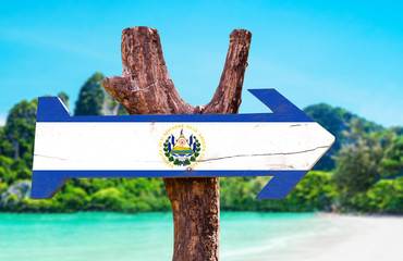 El Salvador Flag wooden sign with beach background