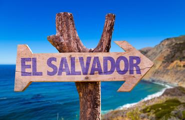 El Salvador wooden sign with coast background