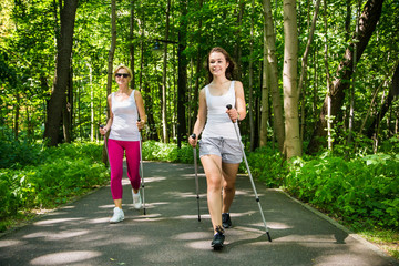 Nordic walking - active people working out in park Wall mural