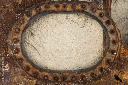 Rusty window frame in the sand\