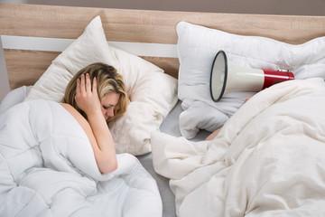 Couple With Duvet In Bedroom