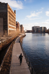 Man Walks Boardwalk Downtown Milwaukee Wisconsin River Walk