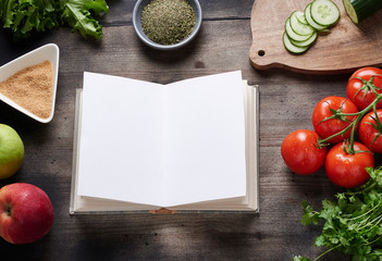 Cooking book on wooden table