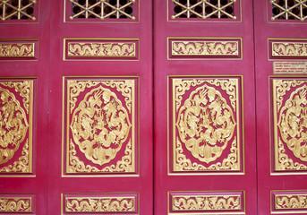 Golden texture on the red doors