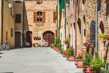 Fototapeta Beautiful colorful streets of the Tuscan town on a sunny day
