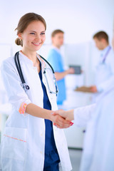Young medical people handshaking at office