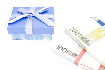 blue gift box and banknotes on white