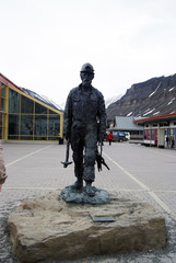 Statue of a miner polar explorer in Spitsbergen, Norway.