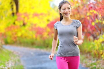 Woman power walking nordic speed walk and jogging Wall mural