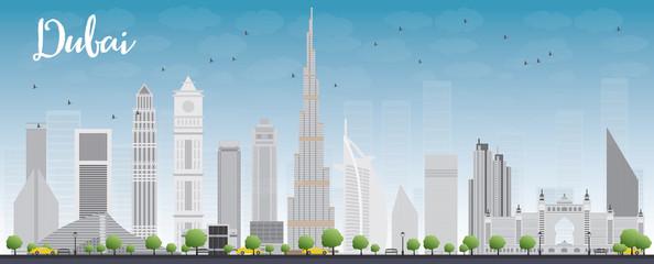 Dubai City skyline with grey skyscrapers and blue sky