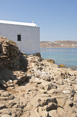 Church in a rocky beach in Mykonos
