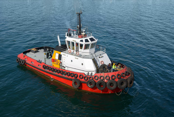 Red tug boat on  water