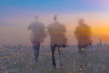 motion blur business people with twilight cityscape background
