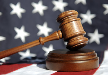 Order in the court - wooden gavel and flag