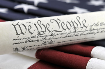 U.S. Constitution document and American Flag