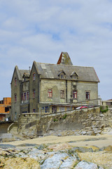 Old tenement on edge of beach in Parque Natural do Litoral on the north of Portugal